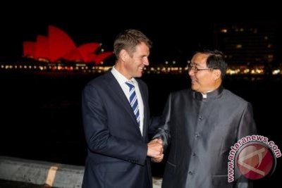 Smiling Mike Baird converts Sydney to chinese