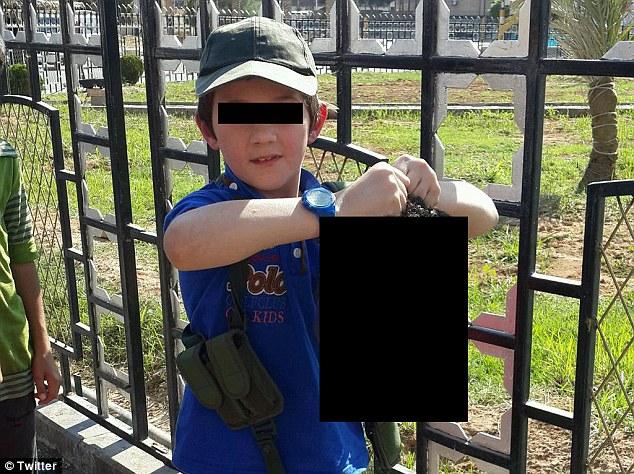 Khaled Sharrouf's son holding a decapitated head