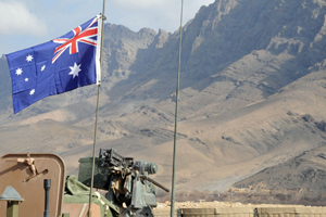 The Australian flag flies proudly above an Australian Light Armoured Vehicle parked inside an Australian and Afghan patrol base in the Baluchi Valley IN Oruzgan Province, Afghanistan.