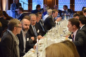 Swiss businss poeple and Austrade colleagues sitting on a long table and talking