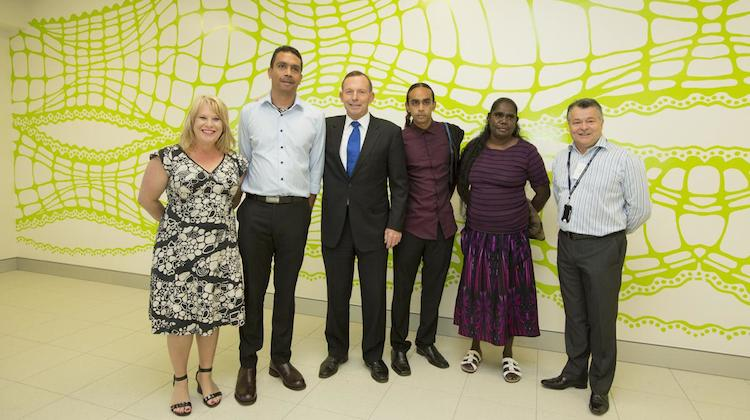 Prime Minister Tony Abbott at the airport opening in front of artist Aaron McTaggart's (second from left) artwork Crocodile that is featured in the new terminal. (Darwin Airport)
