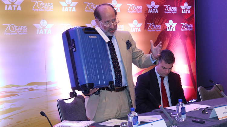 IATA senior vice president for airport, passenger, cargo and security Tom Windmuller with the new optimal size cabin bag. (IATA)