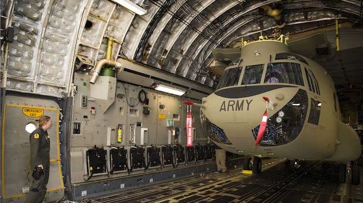One of the three new Boeing CH-47F Chinook helicopters arrives at RAAF Base Townsville on June 13 aboard a US Air Force C-17 Globemaster cargo aircraft. (Defence)