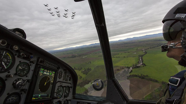 Lieutenant Commander Andrew Kidd, a Qualified Flying Instructor from the Basic Flying Training School, follows a formation of sixteen Pacific Aerospace CT-4B Airtrainer aircraft flying over Tamworth.