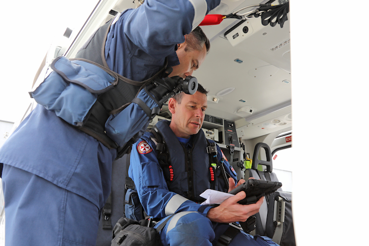 A pilot and paramedic on board Toll Helicopter' AW139 (VH-TJK 'Rescue 204') discuss an upcoming mission to rescue a patient. (Paul Sadler)