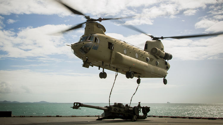 An Australian Army CH-47D Chinook helicopter from the 5th Aviation Regiment in Townsville prepares to lift a 155mm M198 Howitzer from the flight deck of HMAS Choules during an amphibious landing conducted on July 13 as part of Talisman Saber 2017. (Defence)