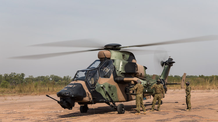 Australian Army soldiers from 1st Aviation Regiment prepare a Tiger Armed Reconnaissance Helicopter for flight at the Forward Arming and Refuelling Point in Robertson Barracks, Darwin.