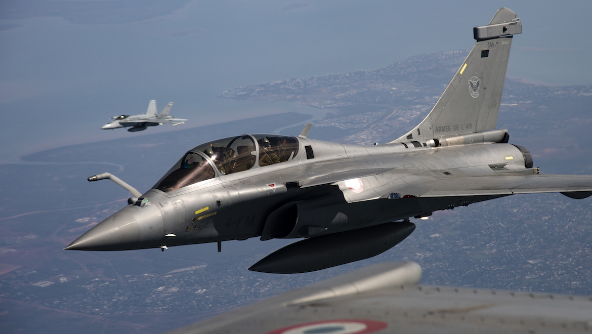 A RAAF Hornet flies in formation with French Rafales. (Richard Nicolas-Nelson)