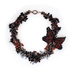 'A butterfly in the garden' by Sally Balfour Flame formed butterfly birds and glass and beads, intricately woven together.