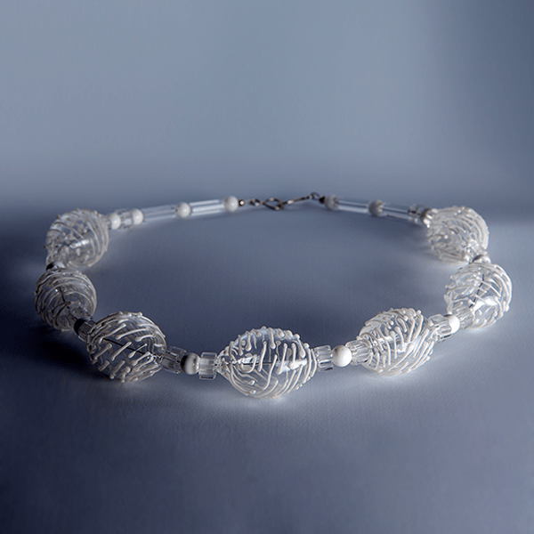 White textured flame worked beads by Susie Barnes. Sterling silver fittings.