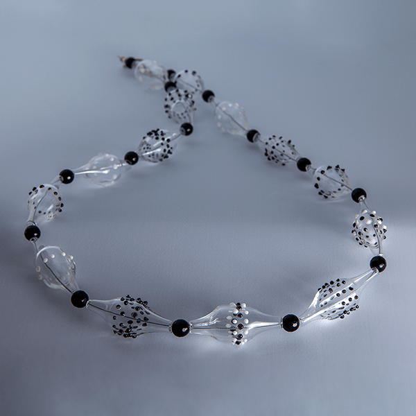 Black and white flame worked beads by Susie Barnes. Sterling silver fittings.