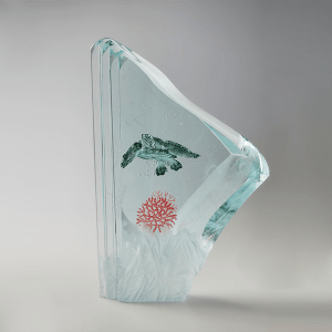 Ocean Vagabond by Peter Nilsson. Laminated sculpted float glass and stained engraving. H 34cm x W 23cm x D 7.5cm