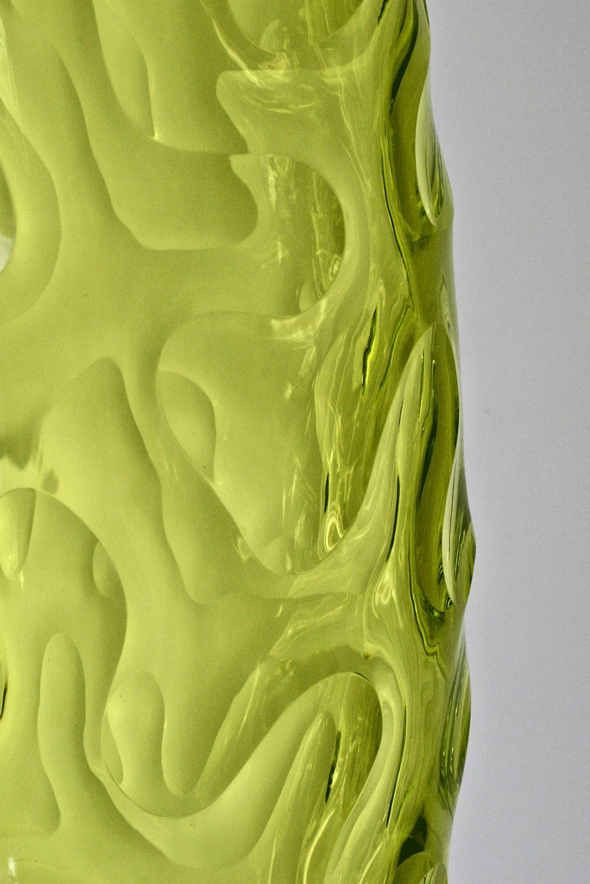 ' Unravelled bottle (citron, green) by Ben Edols and Kathy Elliott. Detail. Blown, carved and polished glass.
