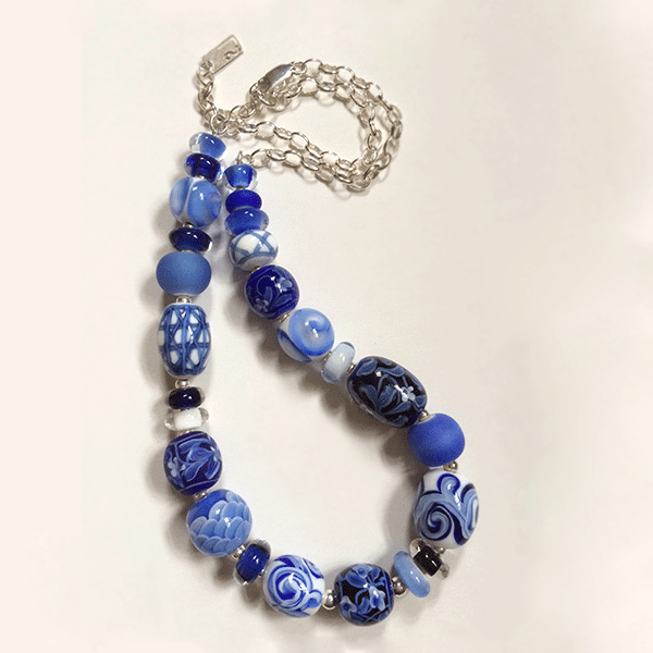Blue and white handmade glass beaded necklace with sterling silver by Lisa Simmons. Length 56cm
