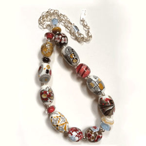 Reds, gold and grey handmade glass beaded necklace with sterling silver by Lisa Simmons. Length 56cm