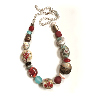 Reds, greens and gold lustred handmade glass beads with sterling silver by Lisa Simmons. Length 56cm