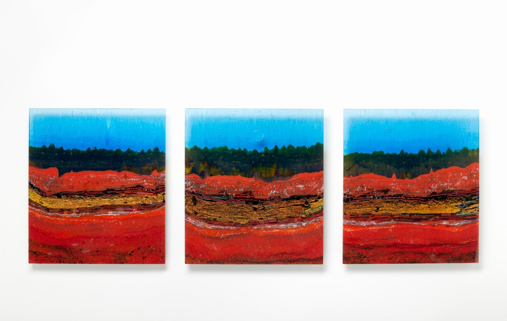 Lasseter's Reef by Gerry King. Kiln formed glass, wall mounted. H 48cm x W 133cm x D 18cm