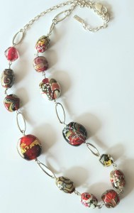 Gold ruby flame formed necklace by Lisa Simmons