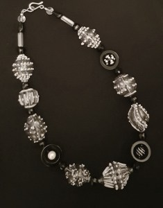 Planet necklace in black and white blown glass beads by Susie Barnes