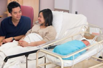 Asian newborn baby girl and daddy in hospital