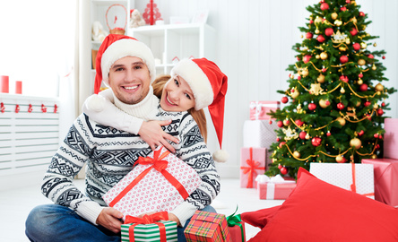happy  family couple with a gift on Christmas at home