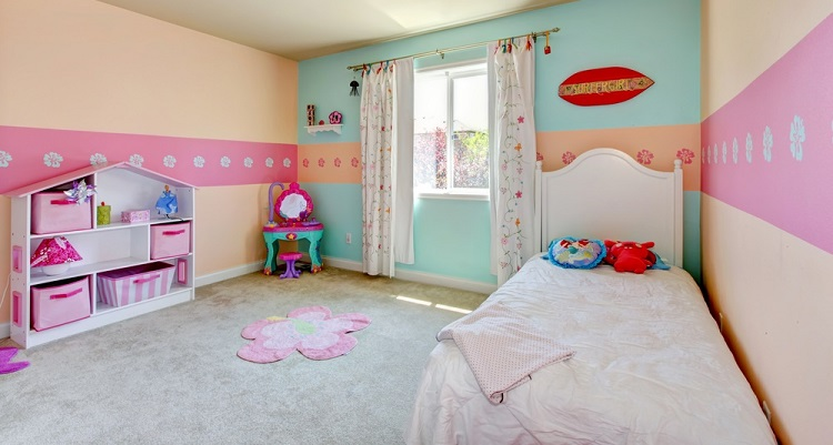 Girl's bedroom with white bed, beige carpet.
