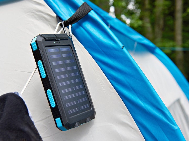 Hiking portable battery with solar panels on tent
