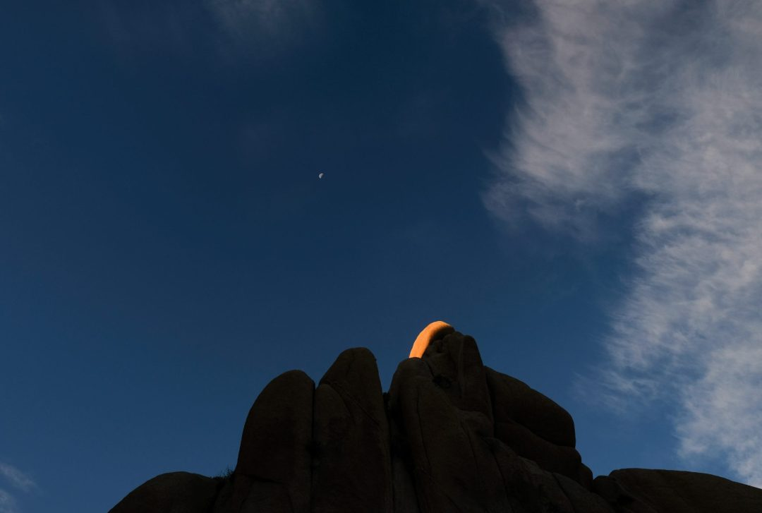 the moon on rocks in Joshua Tree National Park