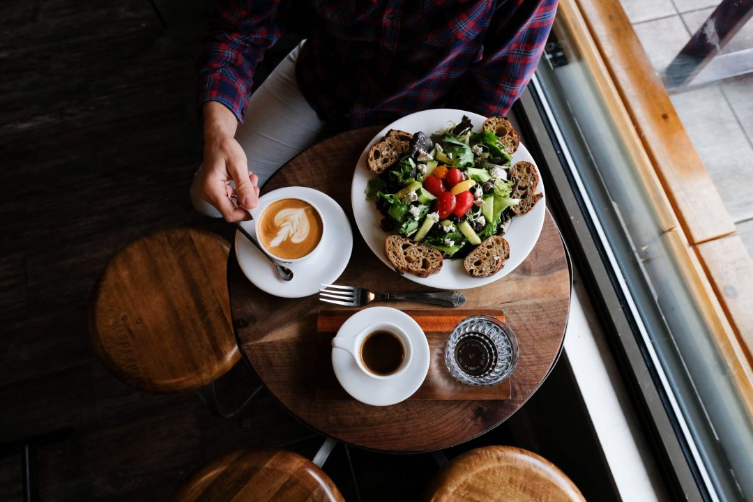 latte art and salad in Archive Coffee and Bar