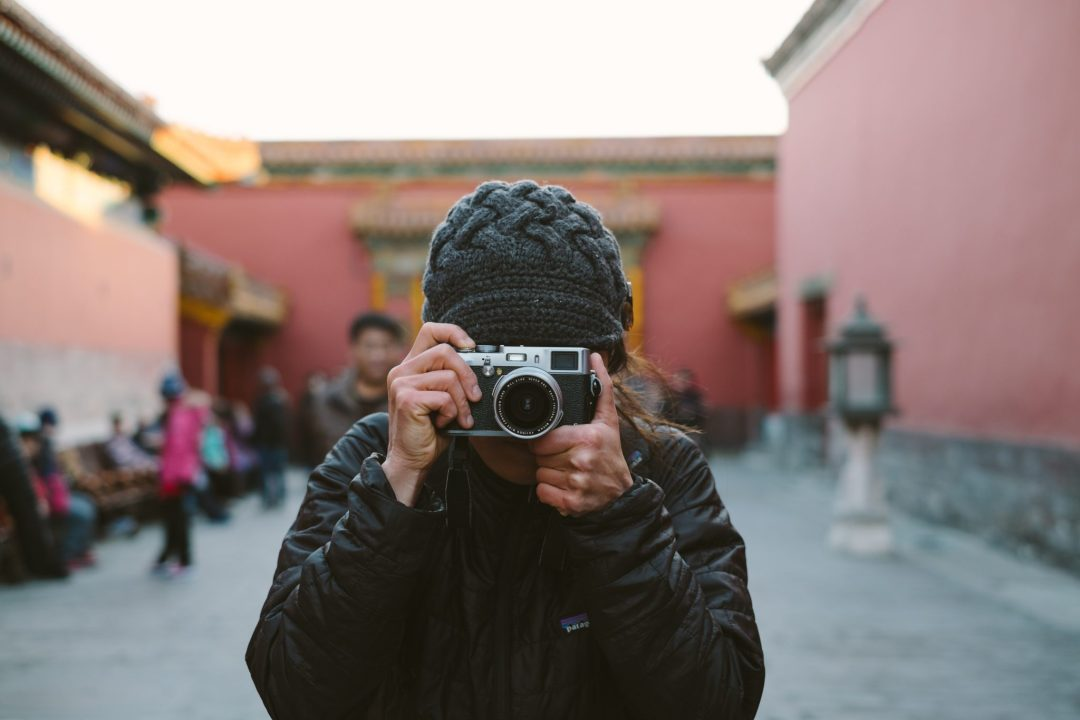 woman taking a photograph in Beijing