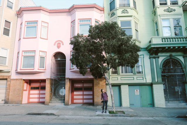 Pastel architecture, leaning tree in San Francisco