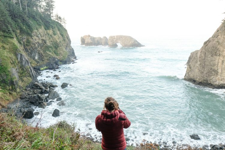 Caroline Whatley taking a photo along the OregonCoast