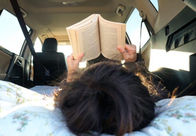 woman reading in a car