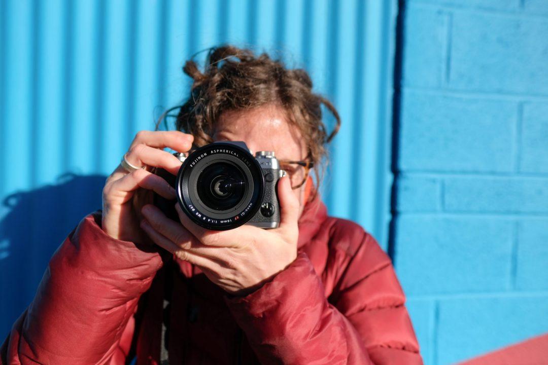Caroline Whatley shooting photos with a Fuji XT-1