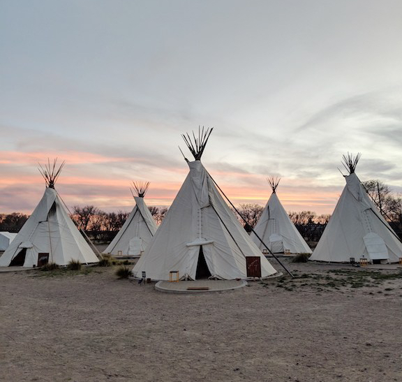 Sunset photograph of tepees at El Cosmico in Marfa, Texas.