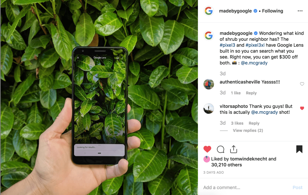 hand holding a photo of the Google Pixel 3a