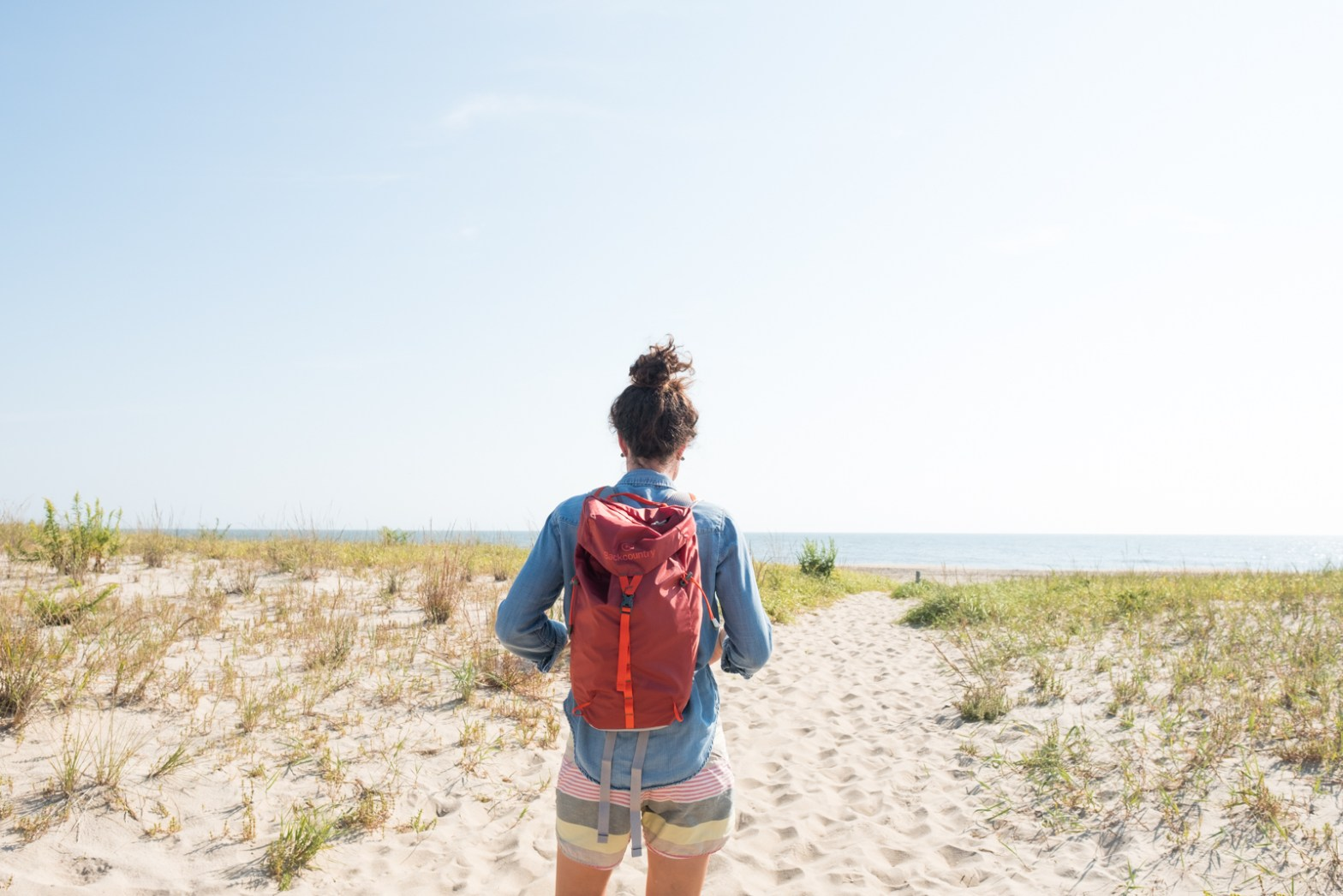 Caroline Whatley at the beach testing out the Backcountry 22L Lightweight pack