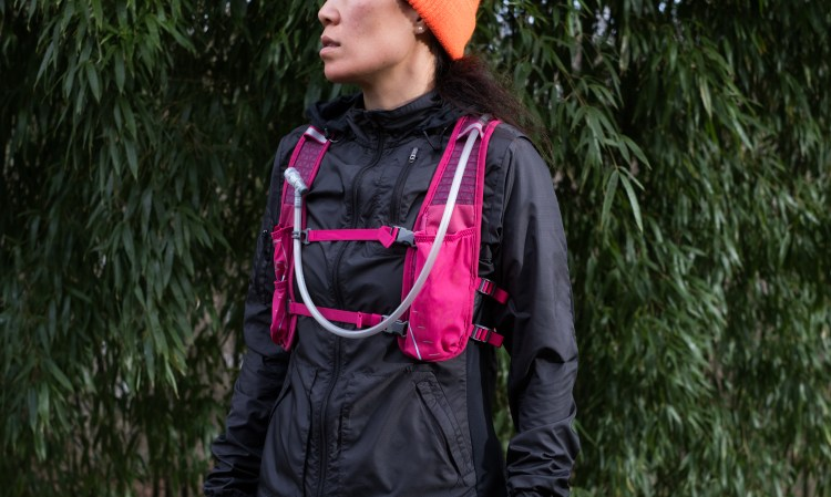 Front view of the Nathan TrailMix 7Liter Women's Multi-Adventure Vest in Sangria/Magenta Purple/Sky Blue