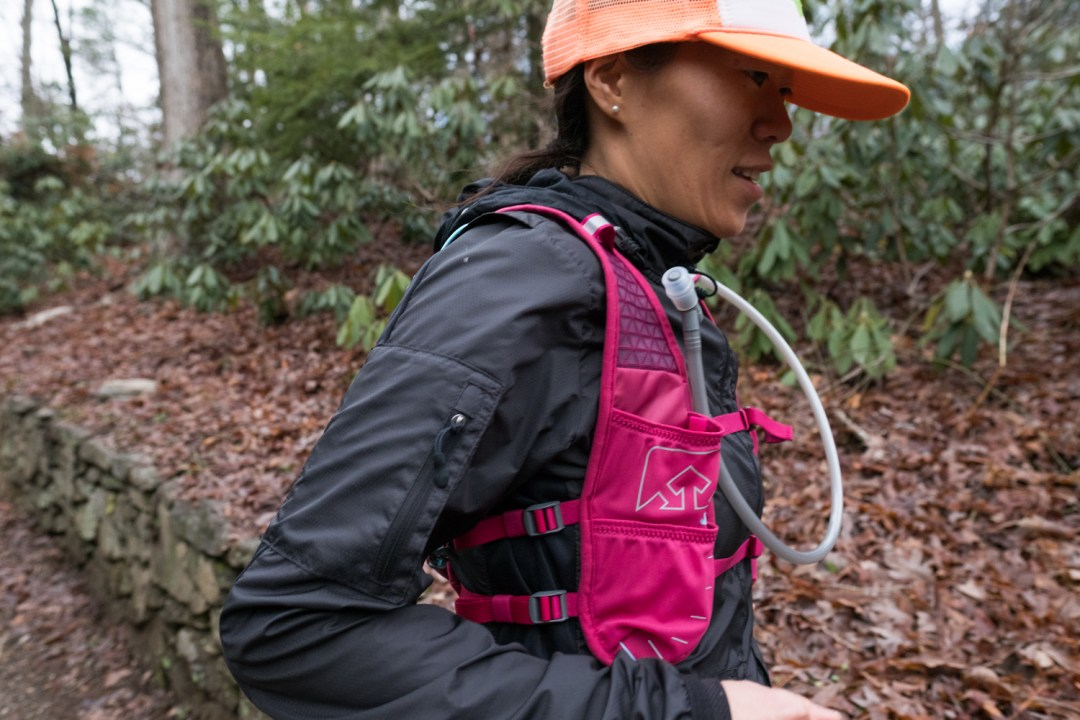 a woman trail running in Asheville, North Carolina