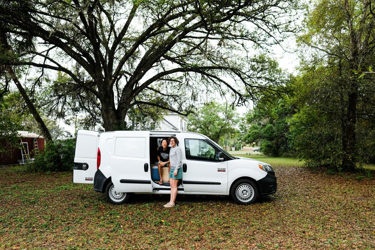two women in a small camper van amid coronavirus (covid-19)