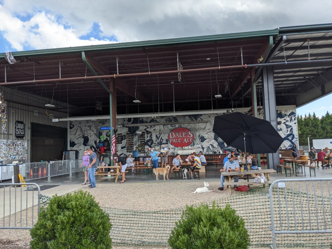 people sitting outdoors at Oskar Blues in Brevard, NC.