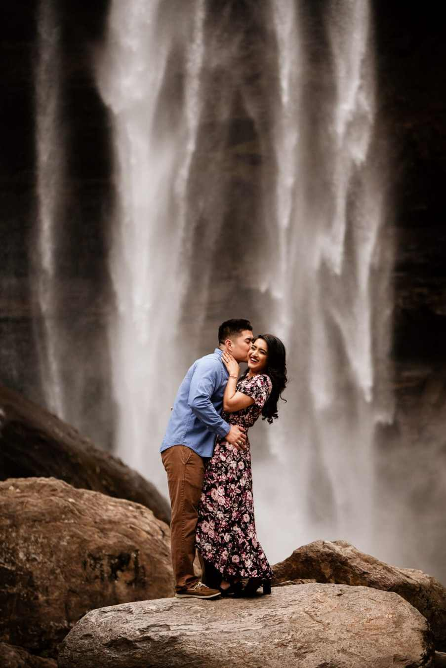 Couple posing in front of Toccoa Falls