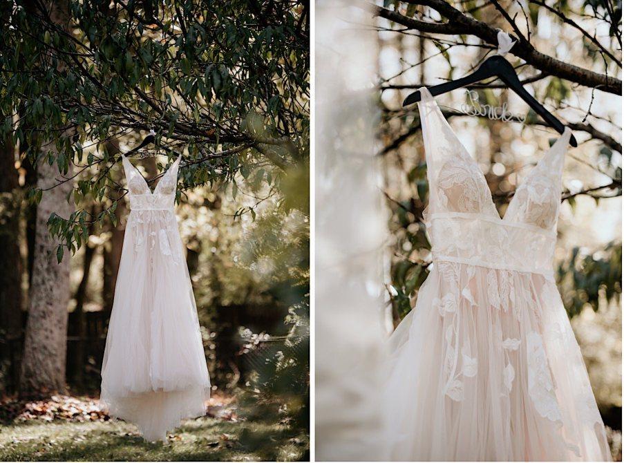 Wedding dress hung on a tree on wedding day photography