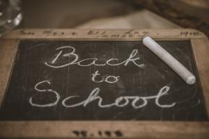 "An image of a black chalkboard with the words ""back to school"" written on it. Parents can get stressed about the start of school. Seeking anxiety treatment in Castle Rock, CO can help you manage stress! 