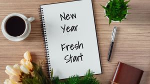 "Image of a notebook reading ""new year fresh start."" Those seeking trauma therapy in the new year can find a trauma therapist by searching ""trauma therapy Castle Rock, CO."" 