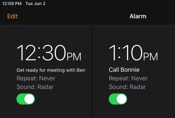 iPhone alarm next to iPhone alarm