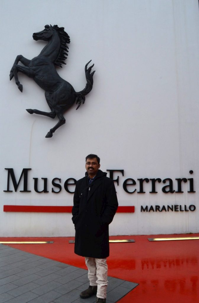 Mahesh standing in front of Ferrari Museum entrance