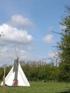 a Red Indian style tipi in a field on the River Wye