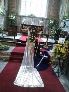 floral arrangement of Queen approaching altar