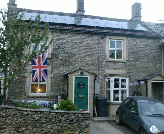Photo of a patriotic house, Union flags flying